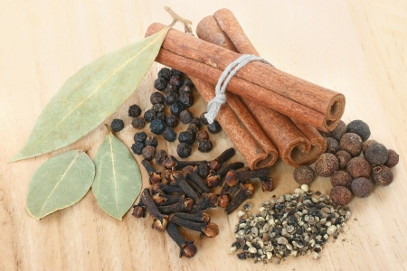 A set of spices on wooden cutting board  photo