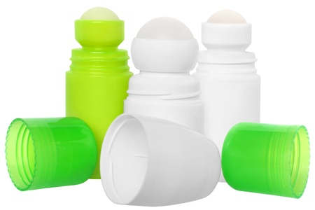 White and green bottles with a deodorant on a white background. photo