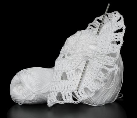 Crochet yarn in white on a black background. photo