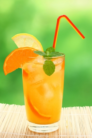 Cocktail with tangerine and lemon juice with ice cubes on a blurred background. Stock Photo - 16957291