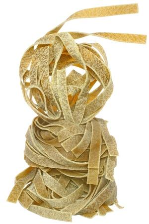 semolina pasta: Durum wheat semolina pasta with spinach tower close up on a white background. Stock Photo