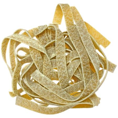 semolina pasta: Durum wheat semolina pasta with spinach close up on a white background. Stock Photo