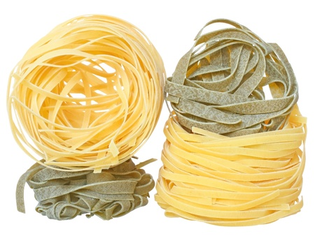 semolina pasta: Durum wheat semolina pasta with spinach on a white background.