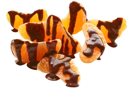 Chocolate covered tangerine stack on a white background Stock Photo - 21403443