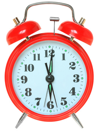 12 o'clock: Red alarm clock on a white