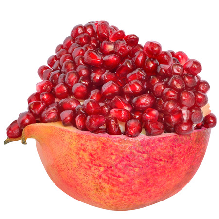 pomegranate: Cut the pomegranate with heap grain isolated on white background. Stock Photo