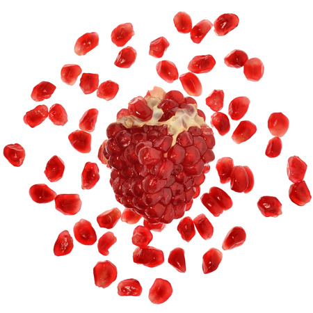 scattered on white background: Pomegranate with scattered grain top view on white background. Stock Photo