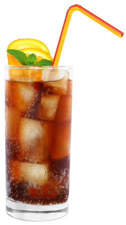 highball: Cola drink with ice cubes and sliced lime in a highball glass on a white background.