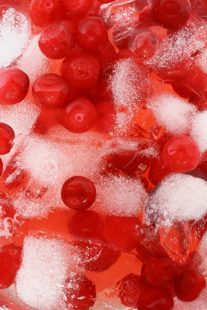 cranberry juice: Cocktail with cranberry juice and ice cubes close up top view Stock Photo