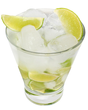 highball: Caipirinha cocktail with ice cubes in a highball glass on a white background.