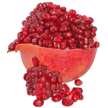 scattered on white background: Cut the pomegranate with scattered grain isolated on white background.