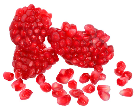 scattered on white background: Scattered grain pomegranate on a white background.