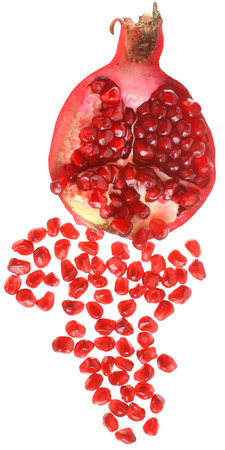 scattered on white background: Cut the pomegranate with scattered grain top view isolated on white background.