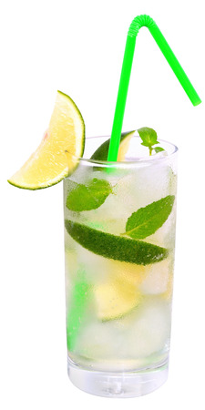 highball: Fruit lemonade with lime and ice cubes and leaf mint in a highball glass on a white background.