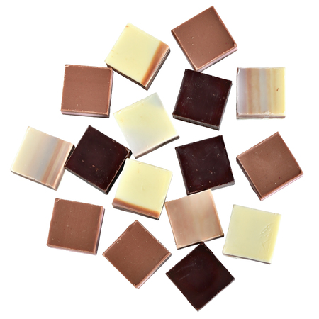 Cubes of dark and white chocolate isolated on a white background.
