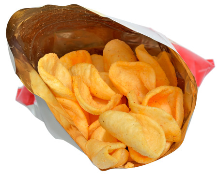 Potato chips in packaging close up isolated on a white background. Imagens