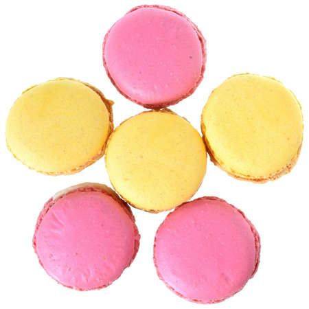 Pink strawberry and peach macarons top view isolated on white background
