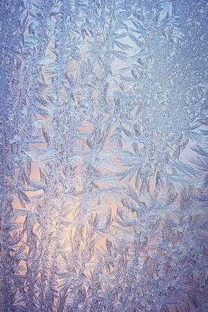Frosty natural pattern on winter window glass  版權商用圖片