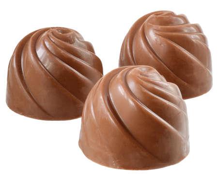Chocolate sweetmeats close up isolated on white background.