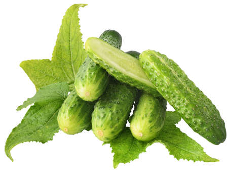 Fresh heap cut cucumber isolated on a white background.