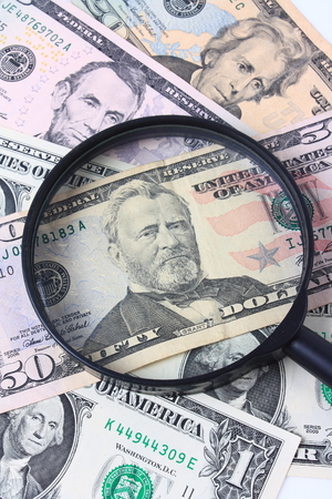 The magnifier and the dollars close up photo