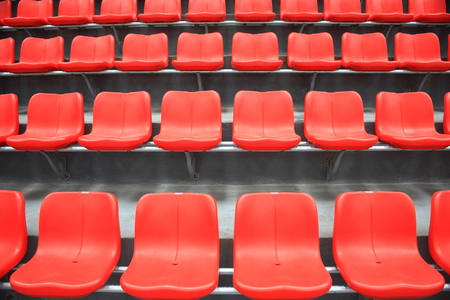 Red seats in the stadium photo