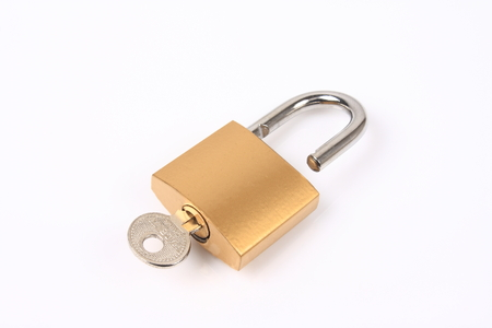 Lock and key on white background photo