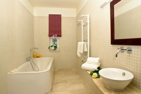 Interiors of a well furnished bathroom.      photo