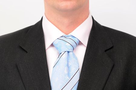 Closeup of businessmans tie, isolated on a white background. photo