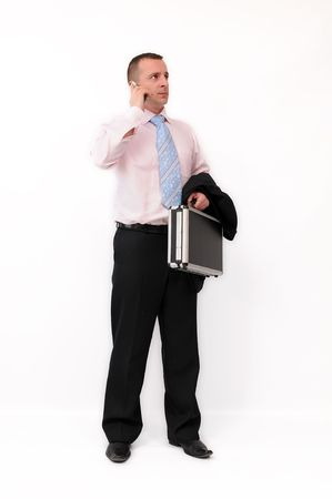 Young adult businessman with briefcase, talking by mobile phone. Isolated on a white background. Stock Photo - 5675823