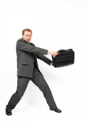 Young businessman protecting important and precious briefcase. Isolated on the white background. photo