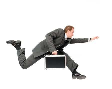 running businessman: Running businessman carrying a briefcase, isolated on a white background.