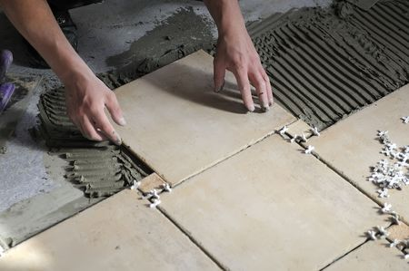 lay: Details of tiles installation on the floor. Stock Photo