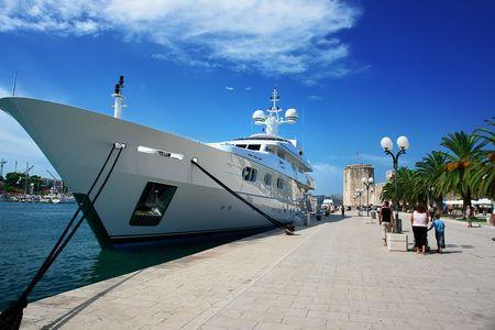 moored: Luxury yacht moored at Makarska harbour under beautiful blue sky.