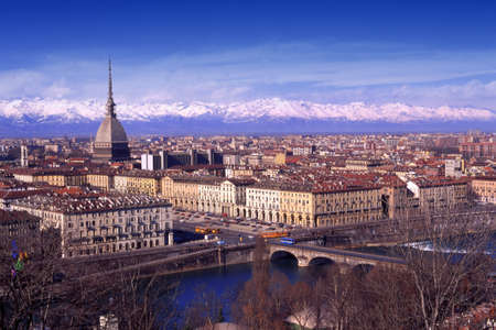 Turin, Italy, skyline of the city with building symbol Mole Antonelliana, Po river and snowy Alps on backgound.