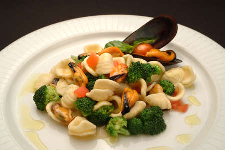Italian Food Recipes. Orecchiette pasta with broccoli and mussels.