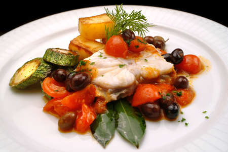 Italian food recipes monkfish with tomato, olives, capers (livornese style)