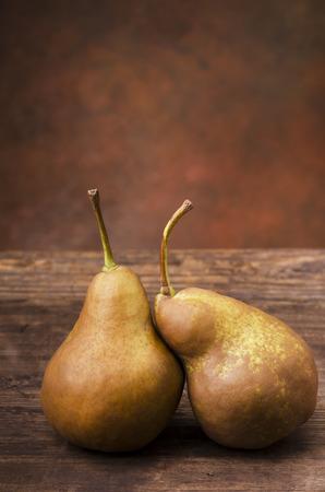 Two fresh pears on rustic wooden background.still life Reklamní fotografie