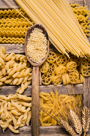 vast assortment of Italian pasta with different sizes and qualities in rustic wooden compartments Reklamní fotografie
