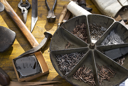 small ancient workshop with tools of the old cobblers craft Reklamní fotografie