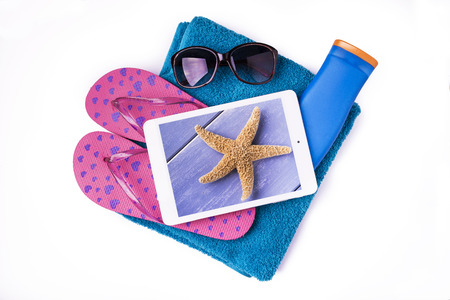 accessories for protection and leisure for a relaxing beach holiday arranged on a white background Imagens