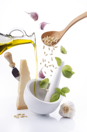 the ingredients for Genoese pesto poured into a ceramic mortar