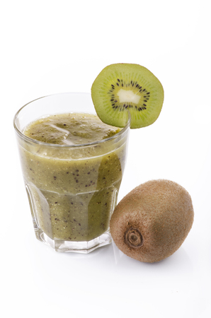 kiwi smoothie in the glass and whole kiwi with white background Imagens