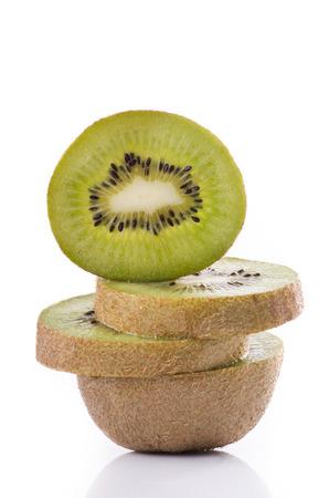 closeup with fresh kiwi slices isolated on white background