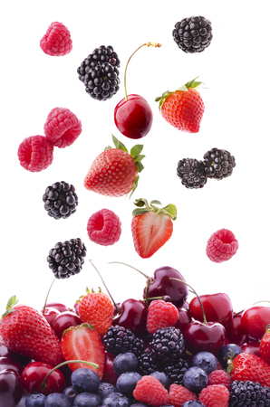 collection of mixed fresh fruit with raspberries, cherries, blackberries, strawberries and blueberries