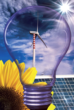 summer landscape with sunflower a solar panel and a light bulb silhouette in the foreground and wind turbine in the background Stock Photo