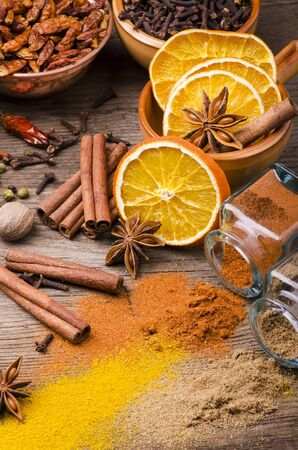 still life.Typologies of brightly colored spices on rustic wooden table