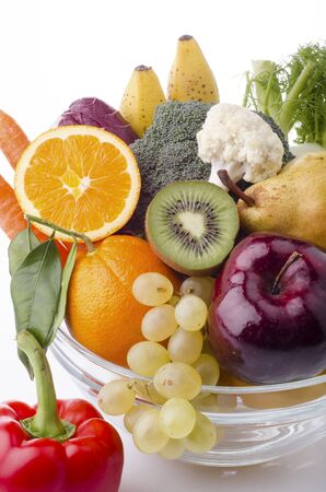 vegetarian diet .Group of vegetables and fresh organic fruit isolated from the white background Stock Photo