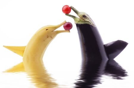 cute animated duet with a banana and a fish-shaped aubergine, isolated from the white background, Reklamní fotografie