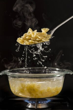 in the transparent glass pot the pasta cooks in boiling water Stock fotó